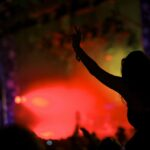 Music revelers dance during to Prodigy's performance on the final day of Bestival 2010 in Newport, Isle of Wight, England on September 12, 2010.